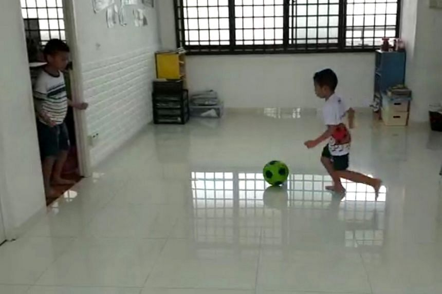Brothers Wong Kai Lei (left) and Kai Yang's own timetable includes playing football at home in their flat.