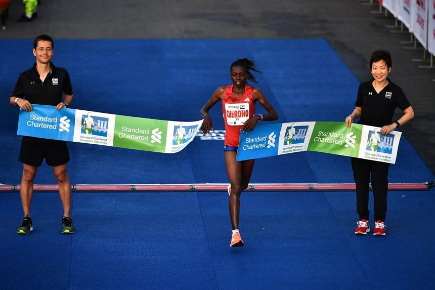 Kenyan's Priscah Cherono wins the women's category with a time of 2:32:12.