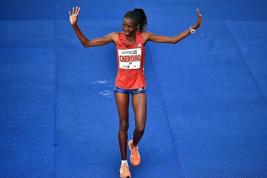 Kenya's Joshua Kipkorir winning the men's race in 2hr 12min 20sec, while compatriot Priscah Cherono (above) was first past the tape in the women's category, clocking 2:32:12.