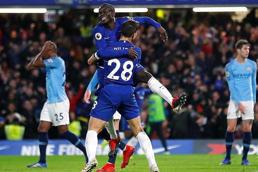 N'Golo Kante celebrating with Cesar Azpilicueta (No. 28) after he scored Chelsea's first goal during Saturday's match against City.