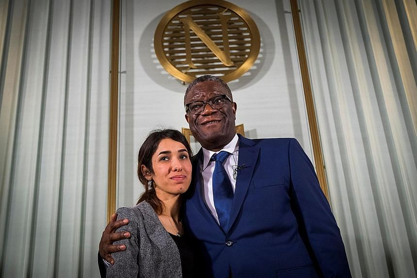 Nobel Peace Prize laureates Yazidi activist Nadia Murad, 25, and Congolese doctor Denis Mukwege, 63, at the Nobel Institute in Oslo yesterday. They will be presented with the Nobel award today in Stockholm.