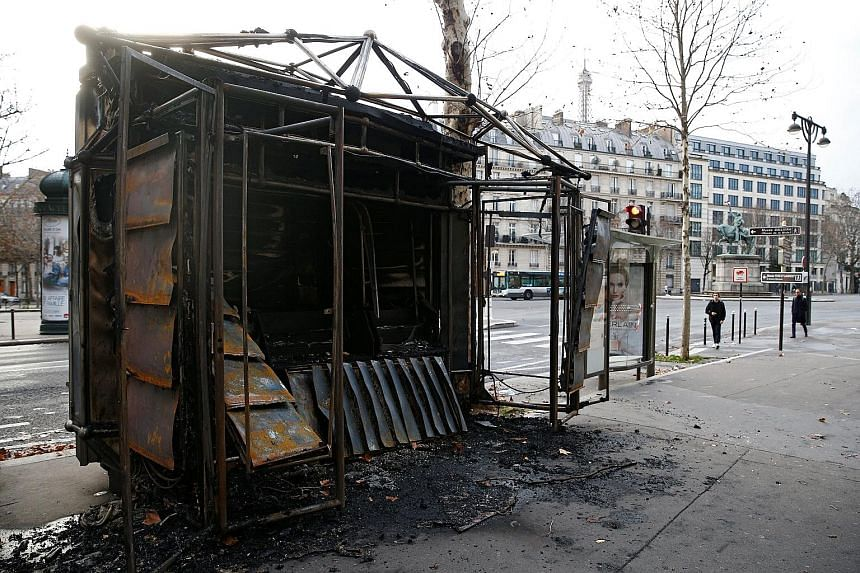 """Paris bore the brunt of the """"yellow vest"""" demonstrations last Saturday, the fourth weekend of nationwide protests in France. Vehicles (above) and a news stand (below) were burnt."""