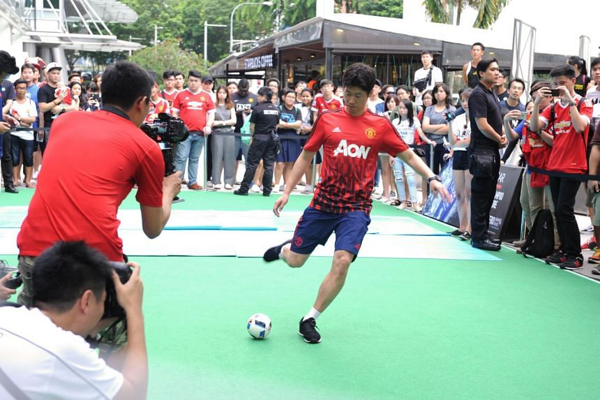 Former Manchester United midfielder Park Ji-sung shows off his striking prowess at a promotional event in Singapore on May 10, 2016.