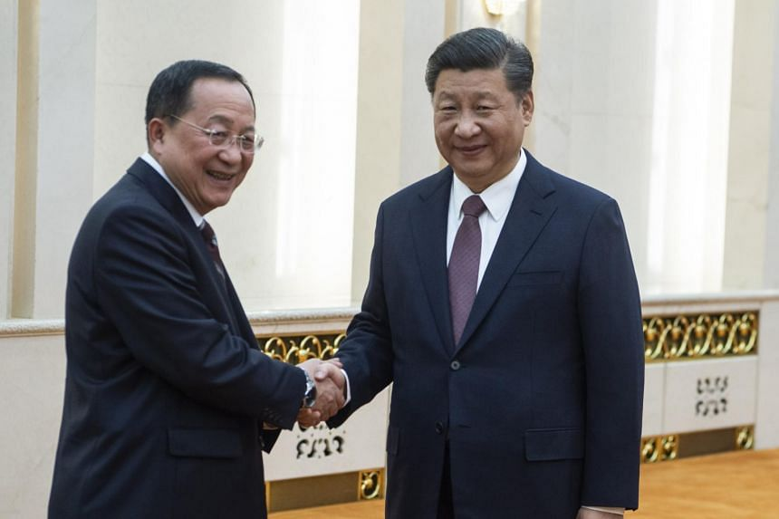 North Korean Foreign Minister Ri Yong Ho (left) met Chinese President Xi Jinping last Friday (Dec 7) for talks, during which Mr Xi reaffirmed his country's strong relations with Pyongyang.