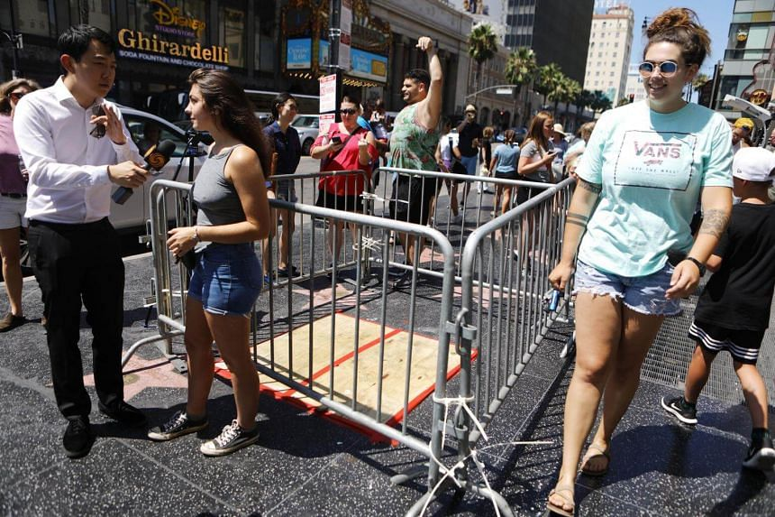 A barricade surrounds the vandalised Hollywood star of US President Donald Trump, on Aug 8.