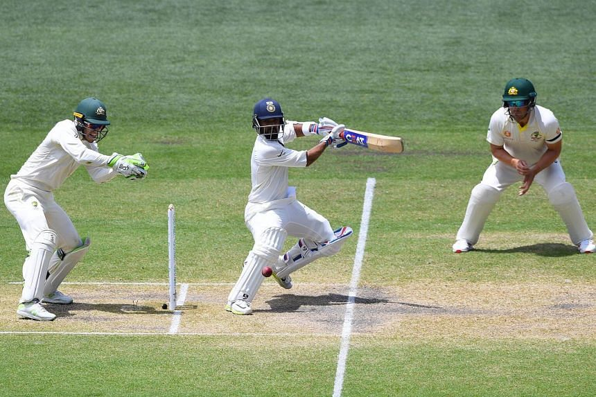 Indian batsman Ajinkya Rahane (centre) plays a shot on day four of the first Test Match between Australia and India, on Dec 9, 2018.