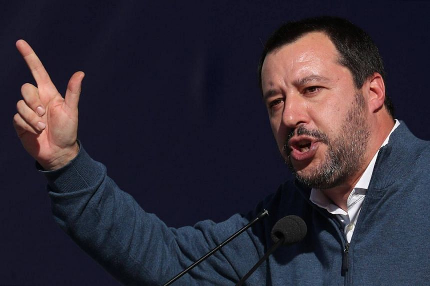 Leader of right-wing League party and Italian Interior Minister Matteo Salvini gestures as he speaks during a rally in Rome, on Dec 8, 2018.