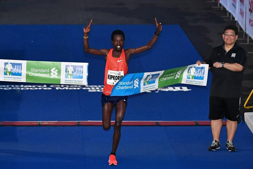Kenya's Joshua Kipkorir (above) winning the men's race in 2hr 12min 20sec, while compatriot Priscah Cherono was first past the tape in the women's category, clocking 2:32:12.