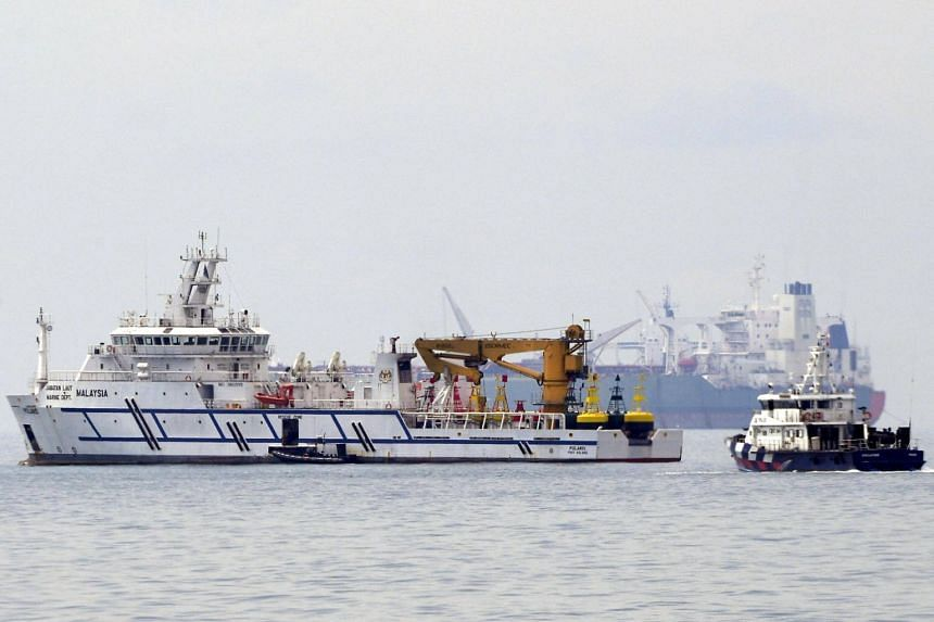 A Malaysian government vessel, Polaris, (left) near a Singapore Police Coast Guard vessel (right), as seen from the south of Tuas View Extension on Dec 6, 2018.