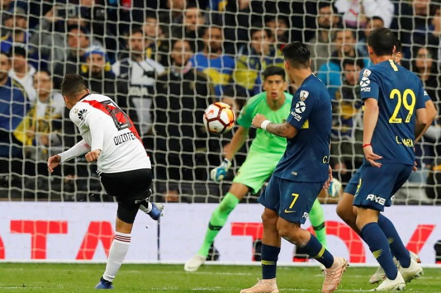 River Plate's Juan Quintero (left) scores the 2-1 lead during the Copa Libertadores final, second leg soccer match between River Plate and Boca Juniors at the Santiago Bernabeu stadium in Madrid, Spain, on Dec 9, 2018.