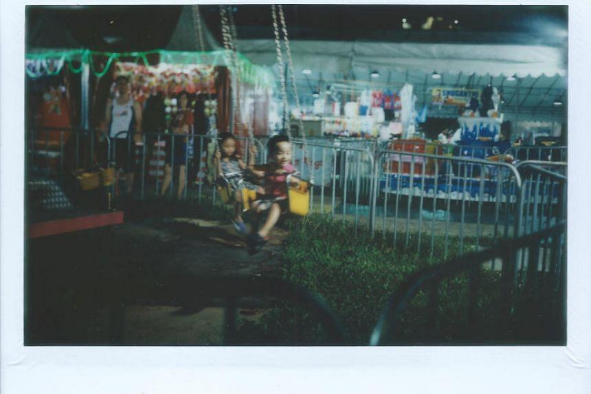 A photo taken with a Modified Polaroid Land 180 camera, shot at Geylang Serai during Hari Raya.