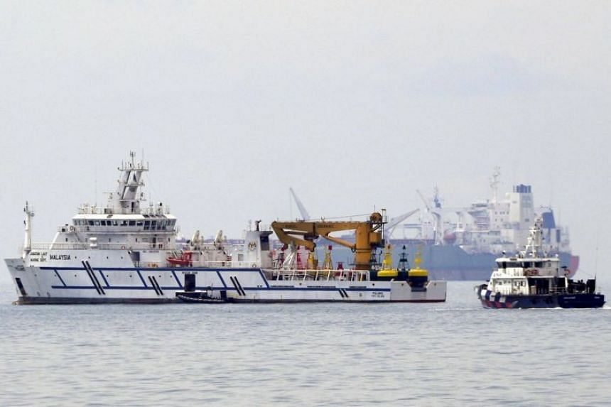 A Malaysian government vessel (left) and a Singapore Police Coast Guard vessel in Singapore territorial waters off Tuas on Dec 6, 2018.