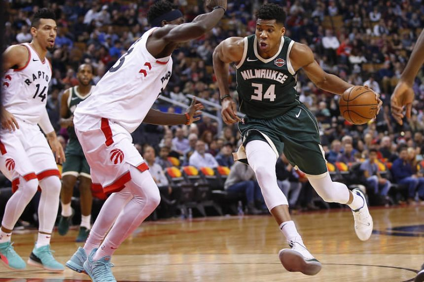 Milwaukee Bucks forward Giannis Antetokounmpo (right) drives to the net against Toronto Raptors forward Pascal Siakam in a match on Dec 9.