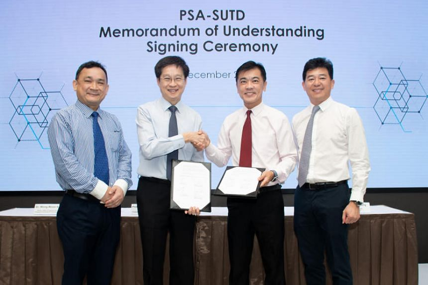 (From left) Dr Wong Woon Kwong, SUTD's director of the office of industry development; SUTD president Chong Tow Chong; Mr Ong Kim Pong, regional CEO of South-east Asia at PSA International; and Mr Ng Kok Cheong, head of human resources at PSA Corpora