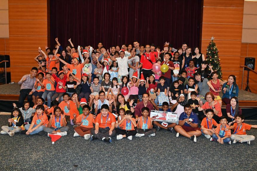 Volunteers and beneficiaries at a year-end lunch party organised by Singapore Press Holdings, which is in its 13th year of collaboration with the Boys' Brigade in the Share-a-Gift initiative.