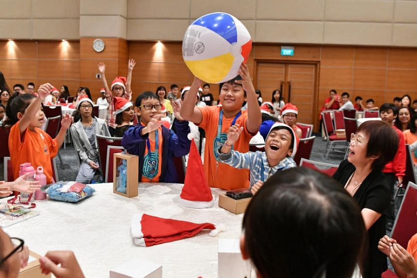 The party at Singapore Press Holdings' News Centre auditorium included food, games and gifts for the young beneficiaries.