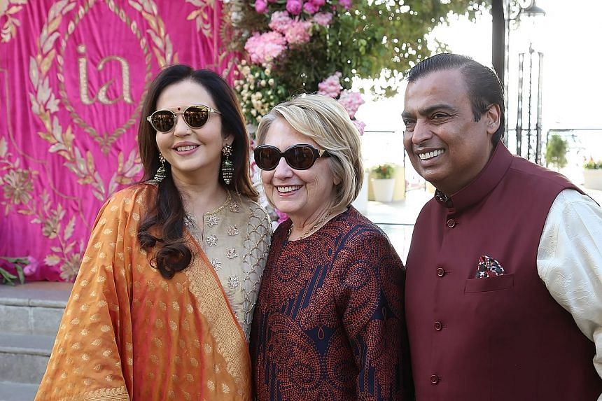 Mrs Hillary Clinton (above centre) received by Mr Mukesh Ambani and his wife Nita in Udaipur last Saturday. Singer Beyonce (left) was flown in to perform at the pre-wedding celebrations of Mr Ambani's daughter Isha.