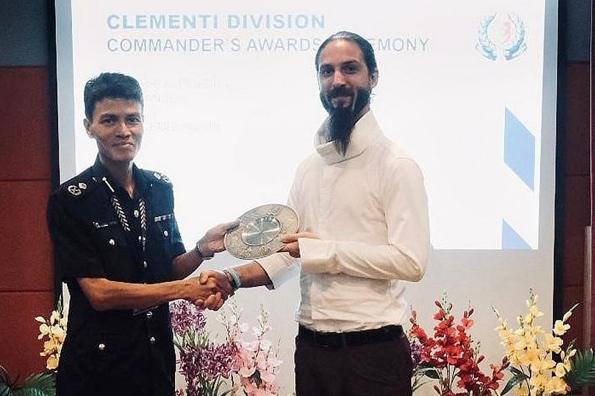 Mr Henry Antoine Nicolas Sebastien receiving the Public Spiritedness Award from Assistant Commissioner of Police Jarrod Pereira, Commander of Clementi Police Division, at a ceremony last Friday.