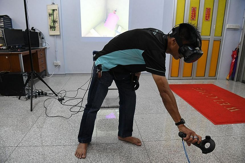 Mr Tan donning a pair of virtual reality goggles as he polishes his skills. Training has allowed him to climb the ranks at local firm Ministry of Clean, and he is now a supervisor after eight years on the job. Singapore Polytechnic students Gary Seah