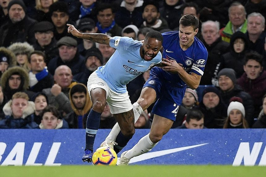 Raheem Sterling being challenged by Chelsea's Cesar Azpilicueta at Stamford Bridge, where he claimed he was abused while retrieving the ball.