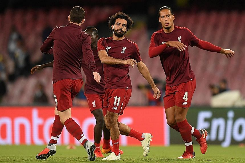 Liverpool will need both forward Mo Salah (left) and defender Virgil van Dijk to be at their best against Napoli at home today. One goal, along with a clean sheet, will be enough to send the Reds through to the Champions League knockout stages.