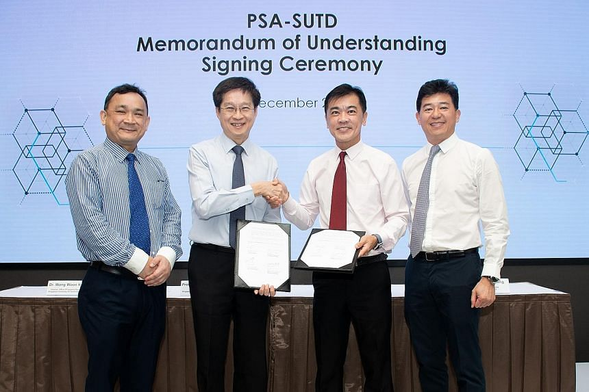 (Pictured from left) Dr Wong Woon Kwong, director of research and industry collaborations at SUTD; Professor Chong Tow Chong, SUTD president; Mr Ong Kim Pong, PSA's regional chief executive for South-east Asia; and Mr Ng Kok Cheong, PSA's head of hum