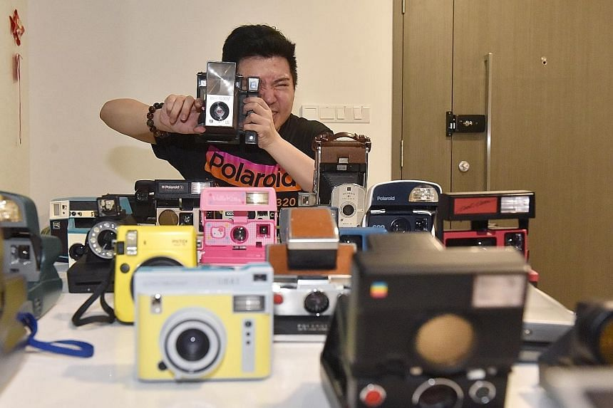 Mr Brandon Ong has about 70 instant cameras, some of which are displayed in his bedroom.