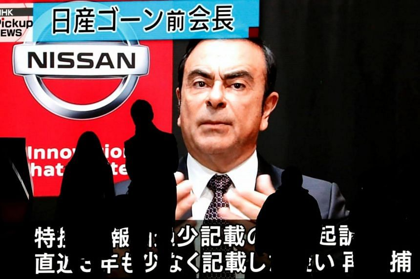 A huge street monitor broadcasts news reporting ousted Nissan Motor chairman Carlos Ghosn's indictment and re-arrest in Tokyo, Japan, on Dec 10, 2018.
