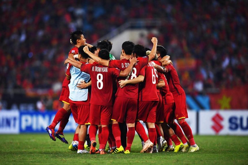Vietnam's players celebrate at the end of the second leg of the AFF Suzuki Cup 2018 semifinal football match between Vietnam and the Philippines at the My Dinh Stadium in Hanoi, on Dec 6, 2018.