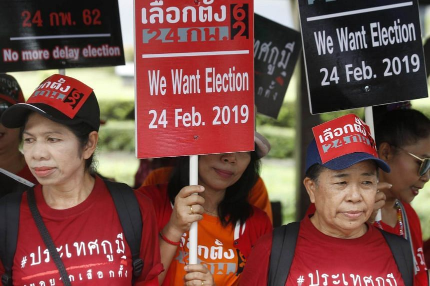 Thai pro-democracy activists hold placards as they gather outside the Royal Thai Army Club in Bangkok, on Dec 7, 2018.