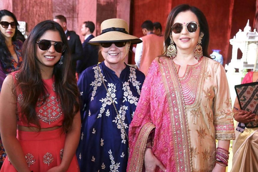Former US secretary of state Hillary Clinton poses with Isha Ambani (left), daughter of Reliance Industries chairman Mukesh Ambani, and his wife Nita Ambani at Swadesh Bazaar, in Udaipur, India, on Dec 9, 2018.