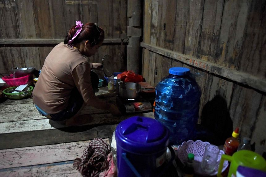Nary, a Cambodian victim of forced marriage to a Chinese man, cooking at home in Phnom Penh. Nary's ran away with US$3,000 after cajoling the then 17-year-old to leave Cambodia to marry.