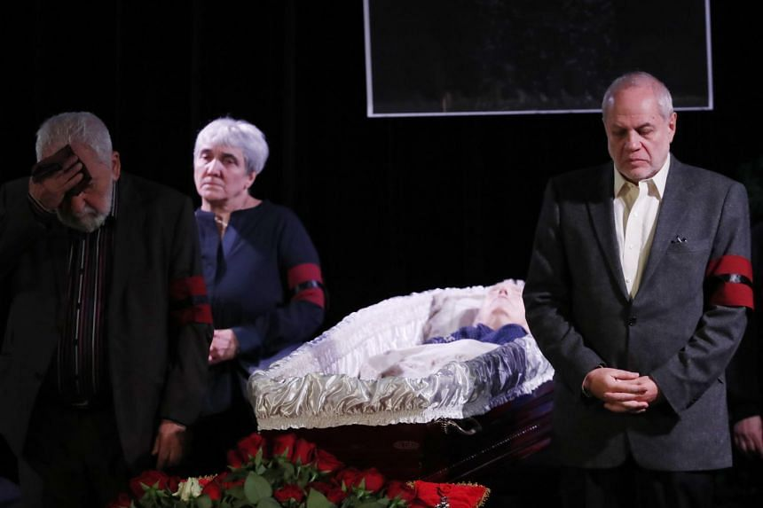 Visitors pay their respects to founder of Russia's oldest human rights group and Sakharov Prize winner Lyudmila Alexeyeva in Moscow on Dec 11, 2018.