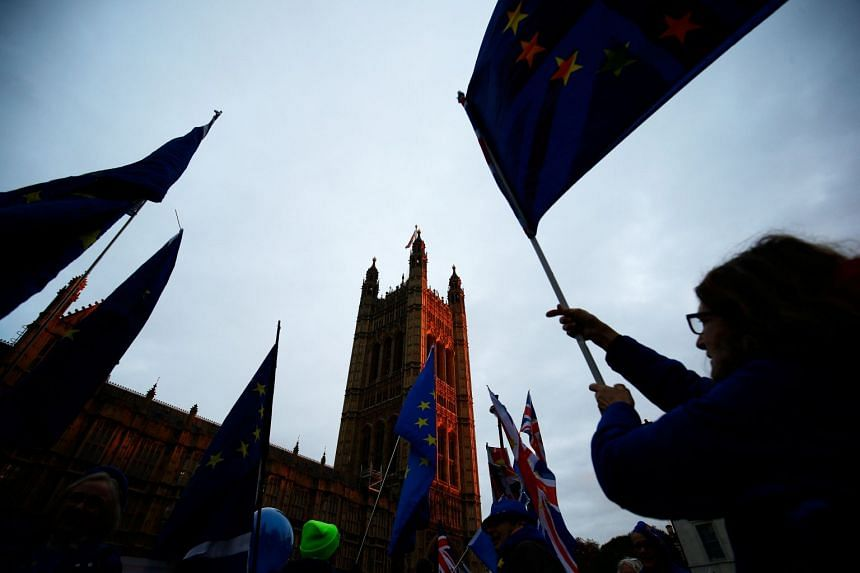 An anti-Brexit demonstrator waves an EU flag outside the Houses of Parliament in London, on Dec 10, 2018.