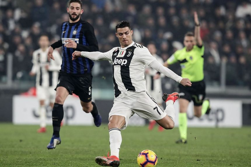 Juventus' Portuguese forward Cristiano Ronaldo on the ball with Inter Milan's Italian midfielder Roberto Gagliardini chasing him in their Serie A football match at the Stadio delle Alpi in Turin on Dec 7, 2018.