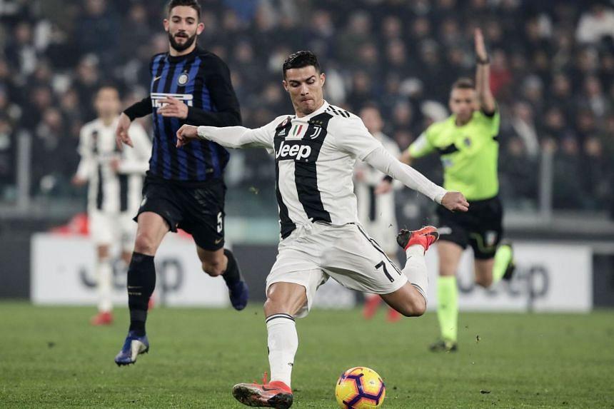 08da57f09033 Juventus' Portuguese forward Cristiano Ronaldo on the ball with Inter  Milan's Italian midfielder Roberto Gagliardini
