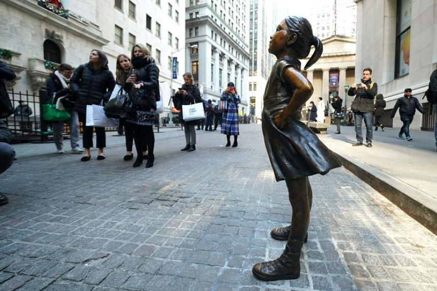 The Fearless Girl statue is unveiled at her new home facing the New York Stock Exchange on Dec 10, 2018.