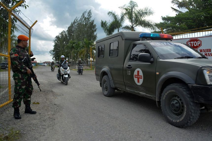 An Indonesian military ambulance evacuates the body of a soldier in Wamena, Papua, on Dec 5, 2018, who was killed after coming under rebel gunfire.