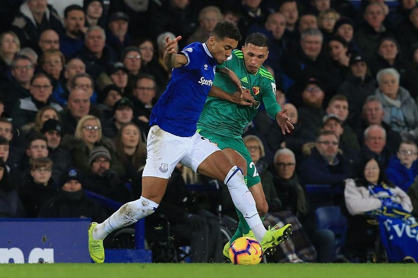 Watford's midfielder Jose Holebas (right) vies with Everton's English striker Dominic Calvert-Lewin during the EPL match between Everton and Watford at Goodison Park in Liverpool, north west England, on Dec 10, 2018.