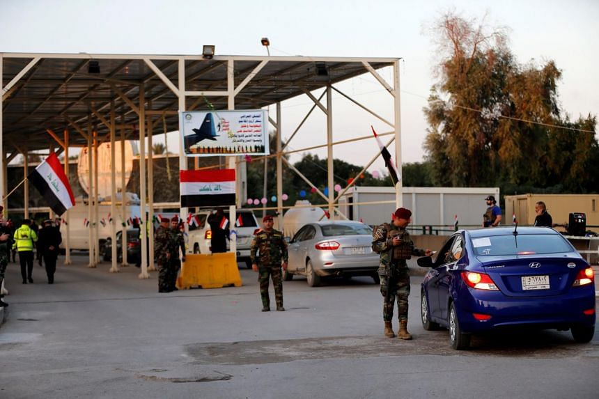 The reopening came on the anniversary of Iraq's recapture of its northern city, Mosul, from the Islamic State in Iraq and Syria (ISIS), and officials said it would be a trial opening over the coming two weeks.