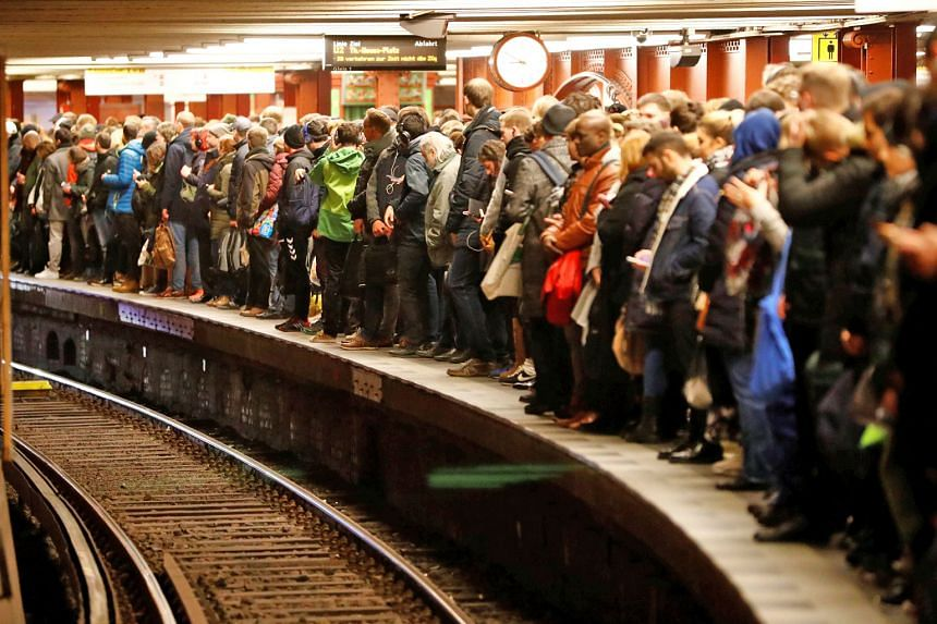 Commuters waiting on the platform for a U-Bahn underground train at Berlin Alexanderplatz station yesterday during a rail workers' strike across the country over a pay dispute. The union is demanding a 7.5 per cent salary rise for 160,000 employees