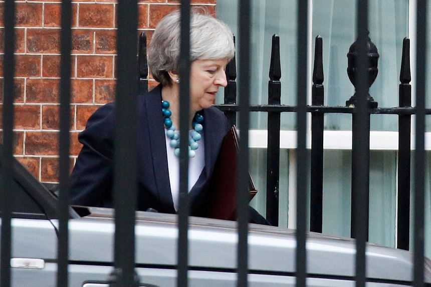 British Prime Minister Theresa May leaving Downing Street yesterday. She said she would do all she could to secure further assurances from the European Union on the Northern Irish backstop arrangement which her critics, both supporters of Brexit and