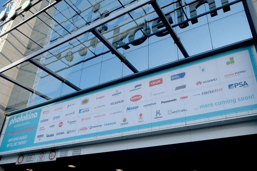 A banner outside the Koelnmesse Hall, where photo trade show Photokina 2018 took place this Sept, showing the exhibitors of Photokina 2019. The event has since been postponed to May 2020. ST PHOTO: TREVOR TAN