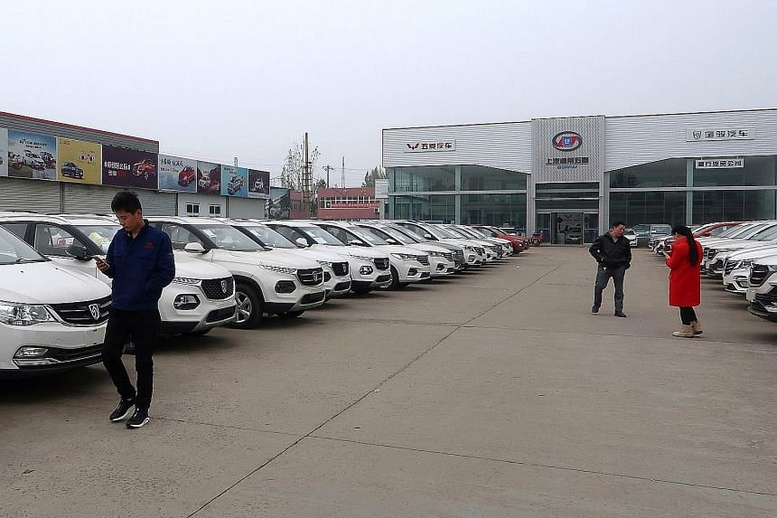 A car dealership in Henan, China. Retail sales of cars in China dived 18 per cent to 2.05 million units last month, falling for the sixth consecutive month. For the first 11 months of this year, car sales have fallen 4.3 per cent. The market is expec