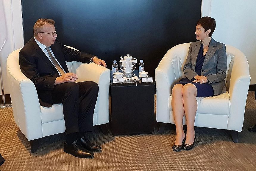 Mr Yury Fedotov, executive director of the United Nations Office on Drugs and Crime, with Minister for Manpower Josephine Teo on Monday.