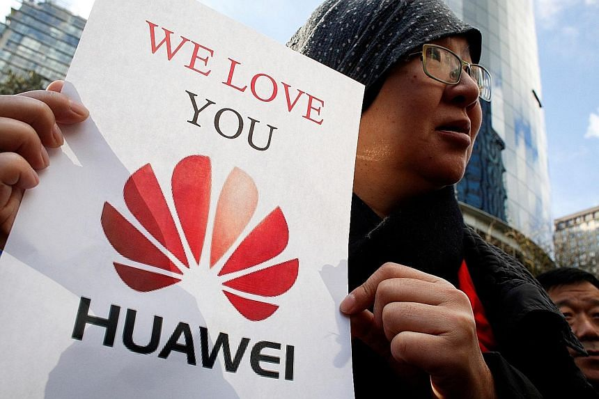 A Huawei supporter outside the British Columbia Supreme Court on Monday where Ms Meng Wanzhou's bail hearing was held. Ms Wang's arrest has stoked public anger in China.