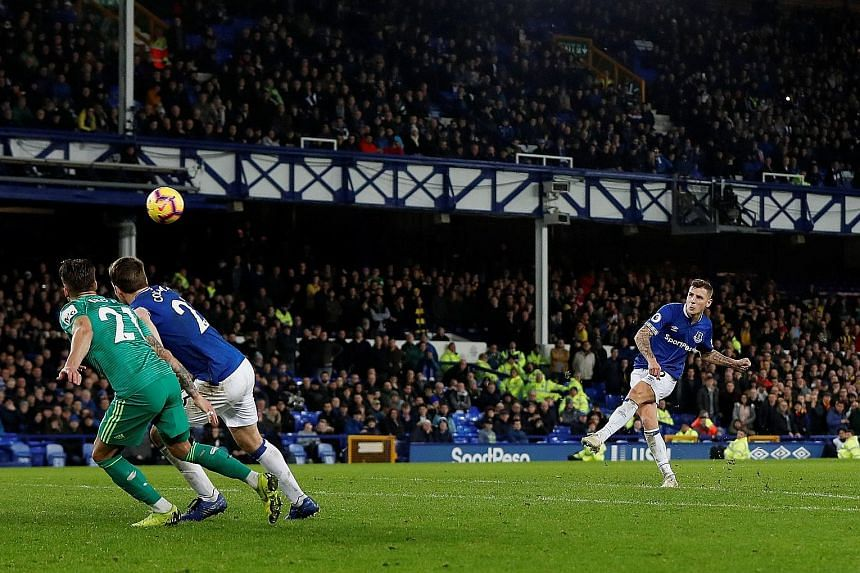 Lucas Digne's brilliant free kick six minutes into injury time snatched a 2-2 draw for Everton against Watford at Goodison Park on Monday. It was the Frenchman's first goal for the club, as Toffees manager Marco Silva avoided defeat by his former emp