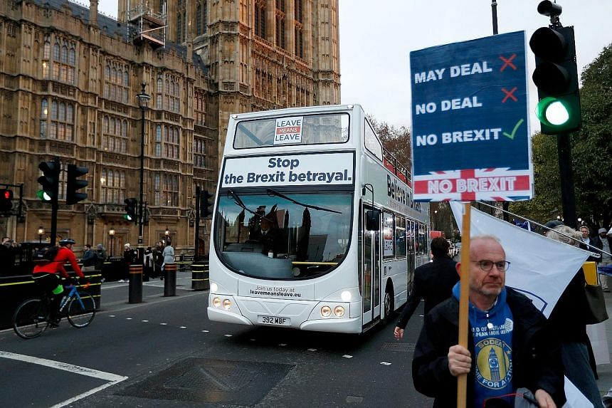 Prime Minister Theresa May telling the House on Monday that the vote would be delayed. Mrs May could now try to break the parliamentary deadlock by calling a general election. An anti-Brexit demonstrator in London. Dozens of MPs have backed calls for
