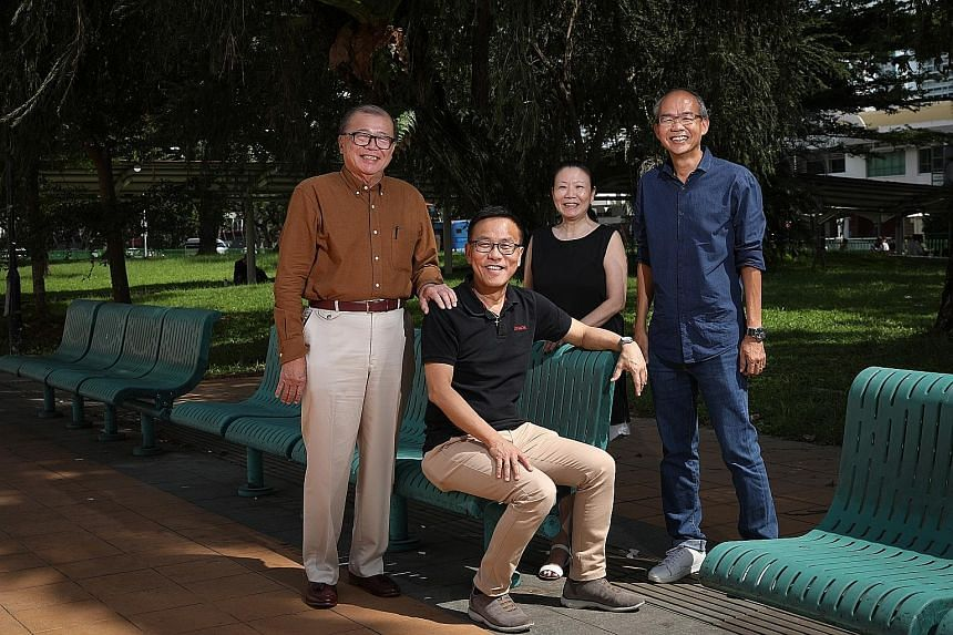 Blessed Grace Social Services founder and executive director Billy Lee (seated) with the Credit Association of Singapore's president Peter Tan (far left), CAS secretary Carol Tan and BGSS chairman Too Lee Soong. Pastor Lee negotiates with moneylender
