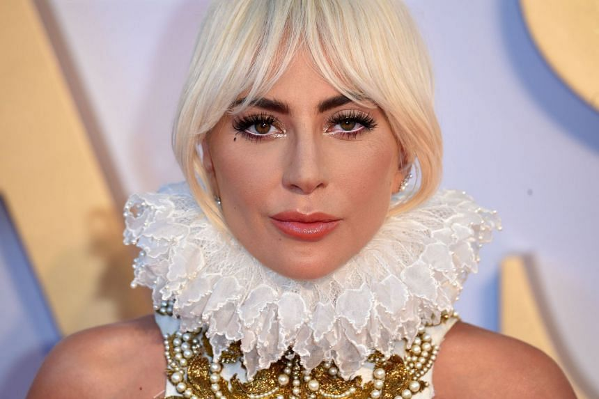 Lady Gaga posing on the red carpet for the London premiere of A Star Is Born.